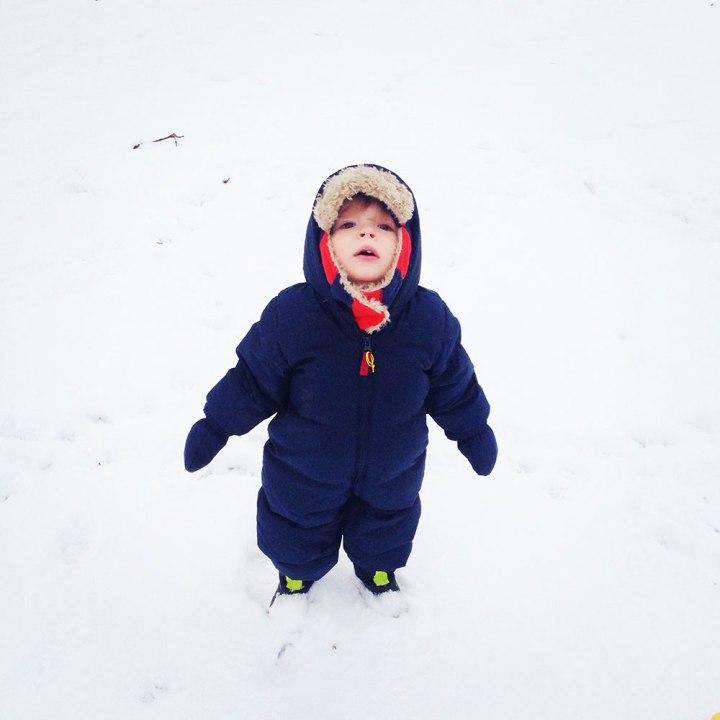 Cute toddler in the snow winter motherhood