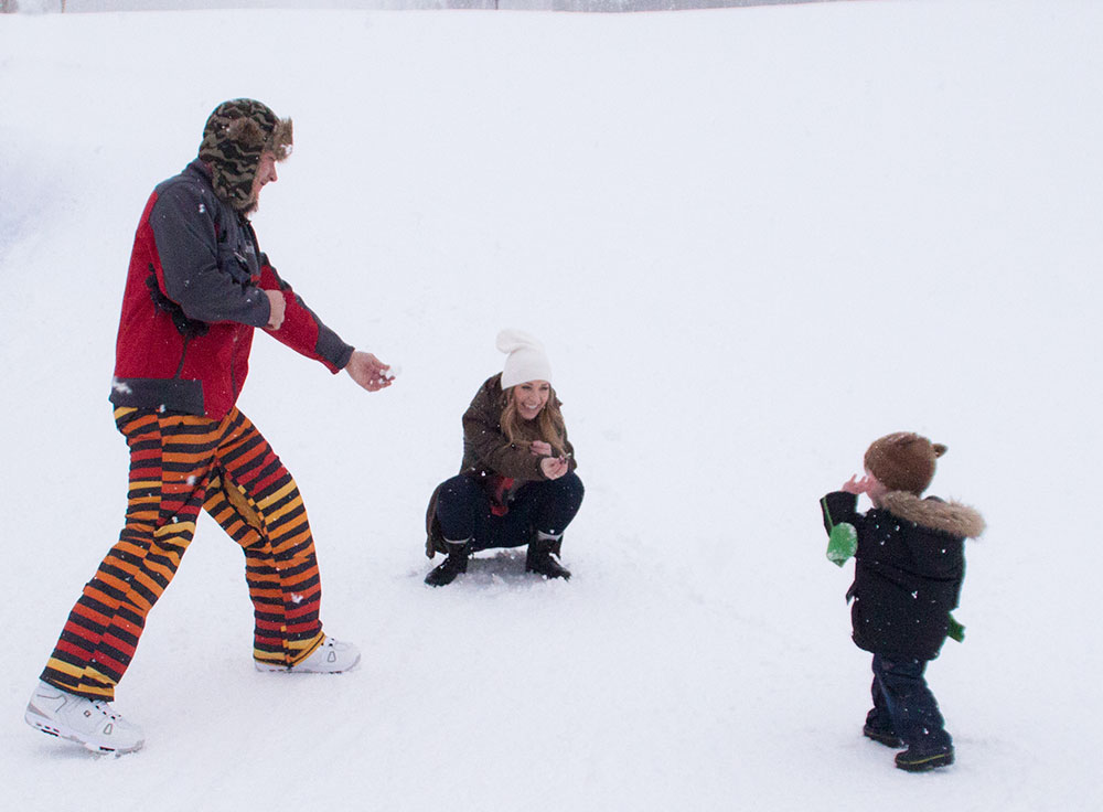 family winter snowball fight